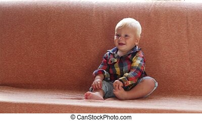 little cute child sitting on a couch