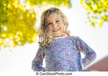 little cute girl 4 years old outside in autumn season