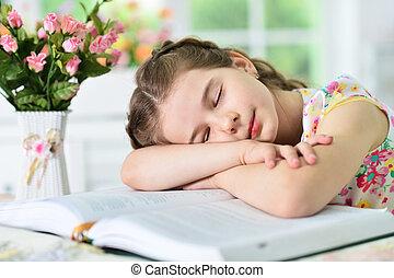 girl falling asleep on book
