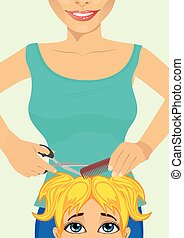 little cute girl getting a haircut at hairdressing salon