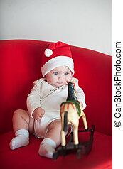 Little cute girl in a Christmas cap