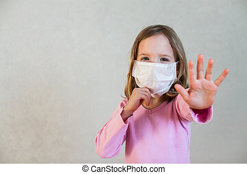little cute girl in a medical mask