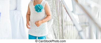 little cute girl in beautiful dress indoors