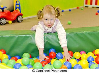 Little cute girl in playroom