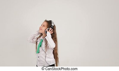 Little Cute Girl Listening to Music With Headphones And...