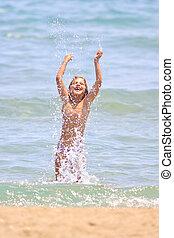 Little cute girl on the beach