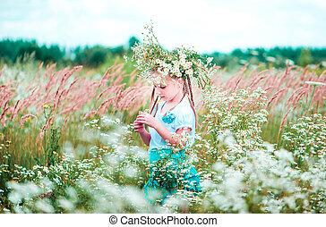 little cute girl on the field