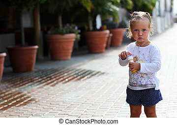 Little cute girl on the street