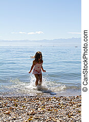 little cute girl playing on the beach