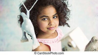 Little cute girl playing toys