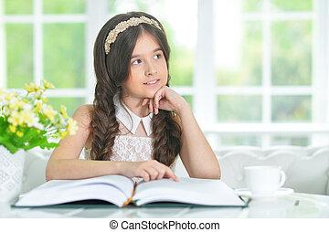 little cute girl reading book