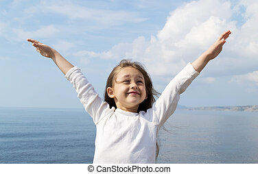 girl standing arms outstretched - little cute girl standing...