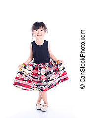 Little cute girl standing over white background
