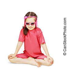 Little cute girl wearing pink clothes is sitting like a yogi