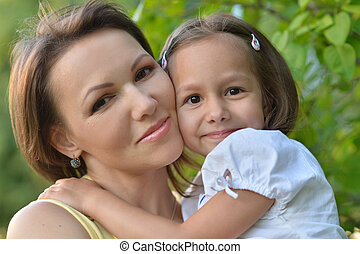 Little cute girl with her mother