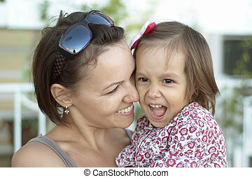 girl with mother in park