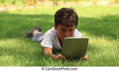 little cute kid using digital table