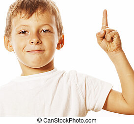 little cute white boy pointing in studio isolated close up...
