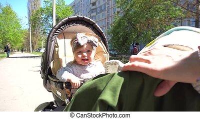 Little cutie baby girl in carriage - Little cutie baby girl...