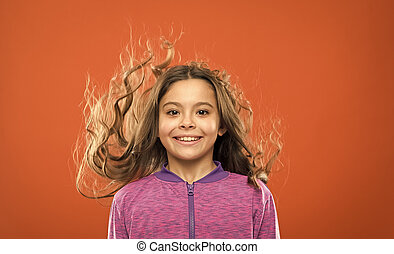 Little cutie. childhood happiness. Family. childrens day. Portrait of happy little child. Kid fashion and sportswear. Happy little girl with long hair. Small girl child. Hairdresser for kids
