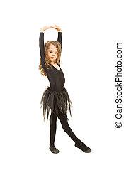 Little dancer girl stretching hands