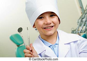 Little dentist - Portrait of happy boy in medical uniform ...