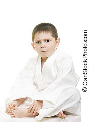 Little displeased karate kid legs crossed