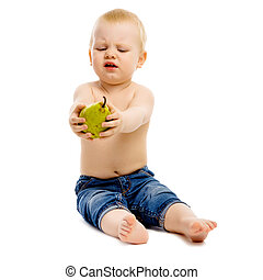 dissatisfied boy disclaims pears on a white background