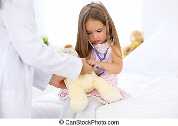 Little doctor examining a 