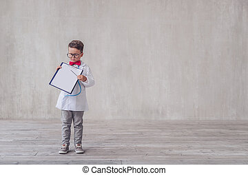 Little doctor with a clipboard