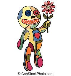 Little doll. flower in her hand.