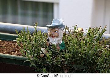 Little dwarf as a decoration in the garden