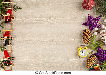 Little dwarf dolls are sitting on the Christmas stairs. Light wooden background and Christmas decorations. Copy space