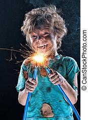 Portrait of little crazy electrician over black background