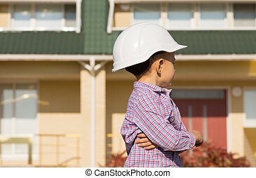 Little Engineer Kid Looking at the House Seriously - Close ...