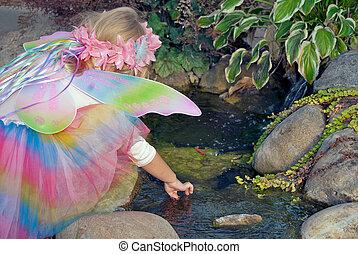 little fairy girl in garden - Little blond fairy girl in...