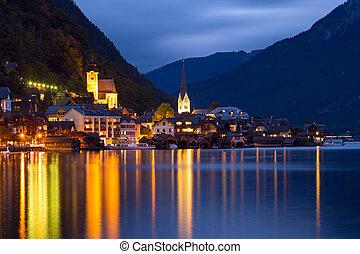Little famous Hallstatt village in Alps at dusk in Austria