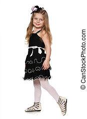 Little fashionable girl in black