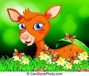 Little fawn in flower garden