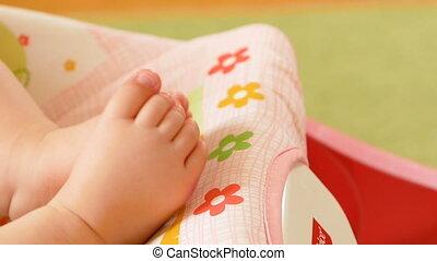 little feet a newborn baby. Slow motion Full HD video