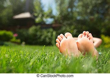 Little feet on the grass, close up photo