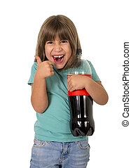 little female child giving thumb up holding big cola soda bottle smiling happy in children sugar addiction and bad habit nutrition