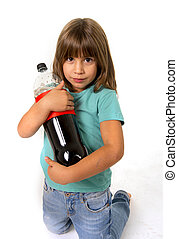 little female child holding big cola soda bottle looking vulnerable in children sugar addiction