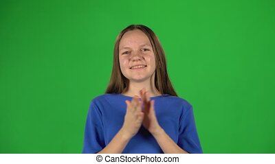 Little female is clapping her hands. Greenscreen - Little...