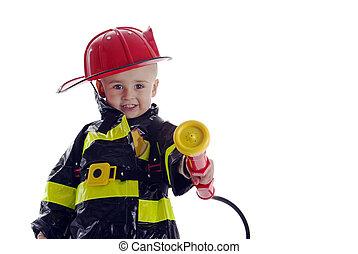 Little fire fighter toddler - Little boy fire fighter points...