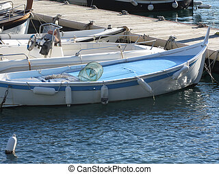 Little fishing boats anchored in a village port of Golfo Dei Poeti, Province of La Spezia, Italy