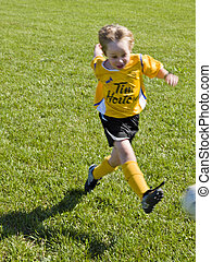 little footballer in action