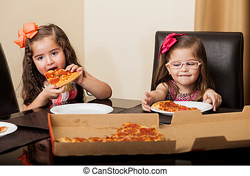 Little friends eating pizza