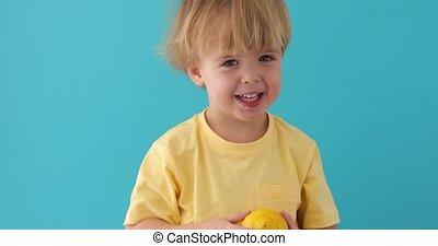 Little Funny boy in shirt keeps lemons - Little Funny boy in...