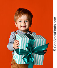 little funny boy with gift